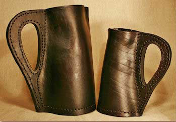 Leather bombards, similar to pitchers handmade by Hidebound. Two- & four-pint versions.