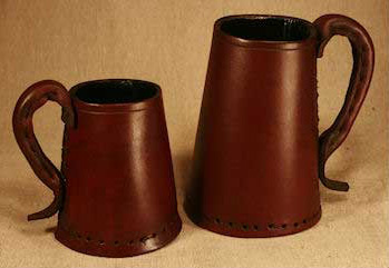 Half pint & One pint full grain leather brown Tudor tankards pictured together