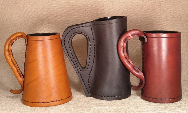 Examples of a Leather Tudor Tankard an Early Medieval Jack and a Late Medieval Jack. All handmade in the UK